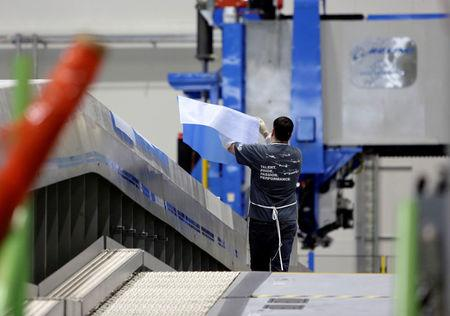 FILE PHOTO:    A Boeing employee moves materials on an automated fiber placement machine during a tour of the composite wing center at Boeing's production facility for the Boeing 777X in Everett, Washington, U.S. October 23, 2017. REUTERS/Jason Redmond/File Photo