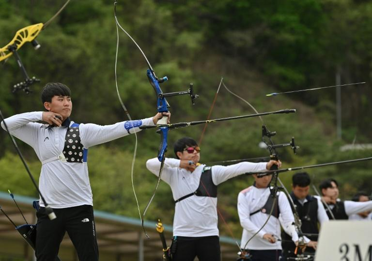 Arrows away: South Korean archer Kim Je-deok (left) competes during the final round of the national archery Olympic team trials at Wonju