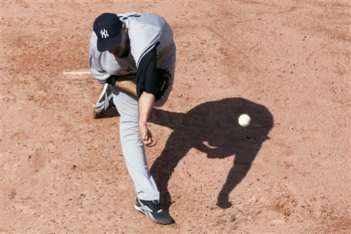 New York Yankees starting pitcher Andy Pettitte works against the Toronto Blue Jays during the third inning of a baseball game in Toronto, Saturday, Sept. 29, 2012. (AP Photo/The Canadian Press, Chris Young)