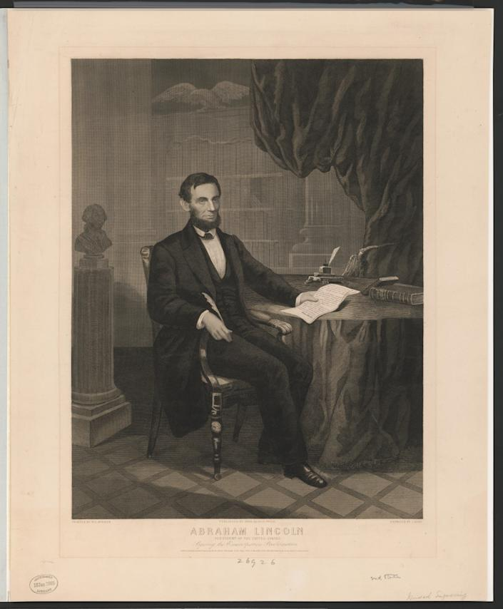 A painting of President Abraham Lincoln signing the Emancipation Proclamation in 1863.