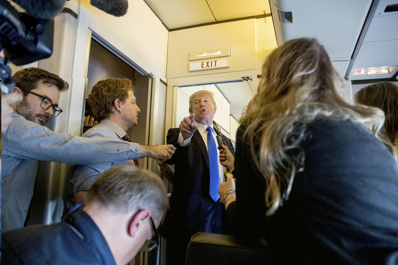 <p>President Donald Trump speaks to reporters aboard Air Force One at Ninoy-Aquino International Airport in Manila, Philippines, Tuesday, Nov. 14, 2017, before traveling to Hickam Air Force Base, Hawaii and then on to Washington. Trump is wrapping up a five country trip through Asia traveling to Japan, South Korea, China, Vietnam and the Philippines. (Photo: Andrew Harnik/AP) </p>