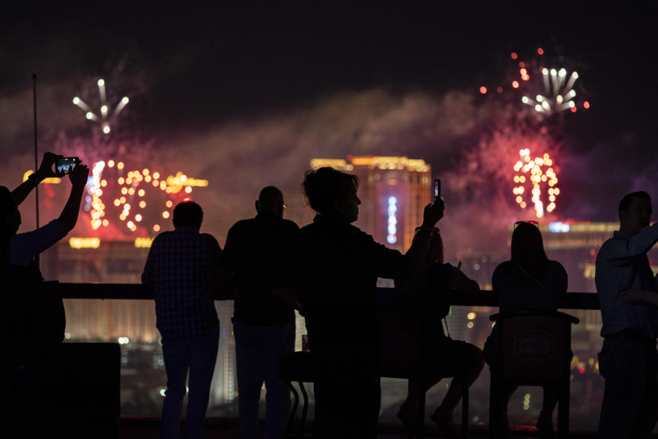 FILE - In this Sunday, July 4, 2021, file photo, spectators watch as fireworks explode over the Las Vegas Strip during a 4th of July Fireworks show in Las Vegas. COVID-19 cases have doubled over the past three weeks, driven by the fast-spreading delta variant, lagging vaccination rates in some states and Fourth of July gatherings. The five states with the biggest two-week jump in cases per capita all had lower rates, Missouri, 45.9%; Arkansas, 43%, Nevada, 50.9%, Louisiana, 39.2% and Utah, 49.5%. (AP Photo/John Locher, File)