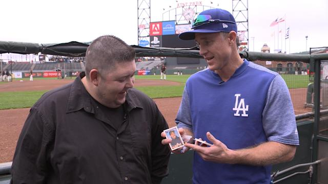 Dodgers second baseman Chase Utley opens 1992 baseball cards. (Yahoo Sports)