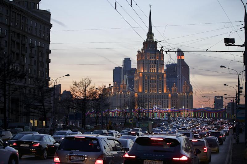 "The Ukraina Hotel is silhouetted against the evening sky in Moscow, Thursday, Feb. 27, 2014. Ukrainian fugitive President Viktor Yanukovych asked Russia on Thursday to protect him from ""extremists,"" as a respected Russian news organization reported that he was seen in a Moscow hotel and was now staying in a Kremlin sanatorium just outside the city. Security at the Ukraina Hotel was unusually heavy late Wednesday, with police watching from parked vehicles outside and guards posted throughout the lobby. Some of Yanukovych's allies, also reported to have been at the hotel, may have still been there. (AP Photo/Alexander Zemlianichenko)"