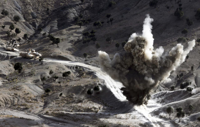 <p>U.S soldiers blow up a roadside bomb set up by Taliban fighters near the town of Walli Was in Paktika province, near the border with Pakistan, Nov. 4, 2012. (Photo: Goran Tomasevic/Reuters) </p>