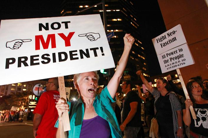<p>Faith Attaguile, from Encinitas, yells chants with others on the corner of Broadway and Front Street , Wednesday, Nov. 9, 2016, in downtown San Diego, during a protest in opposition of Donald Trump's presidential election victory. (Photo: Hayne Palmour IV/The San Diego Union-Tribune via AP) </p>