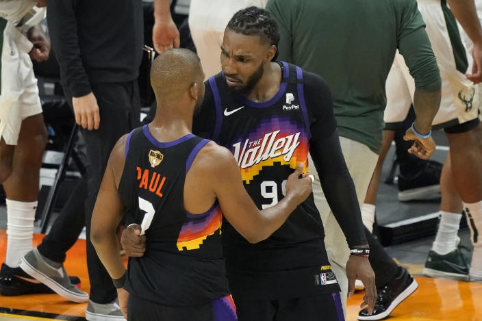 Phoenix Suns guard Chris Paul, left, celebrates with Jae Crowder after the Suns defeated the Milwaukee Bucks in Game 2 of basketball's NBA Finals, Thursday, July 8, 2021, in Phoenix. (AP Photo/Matt York)