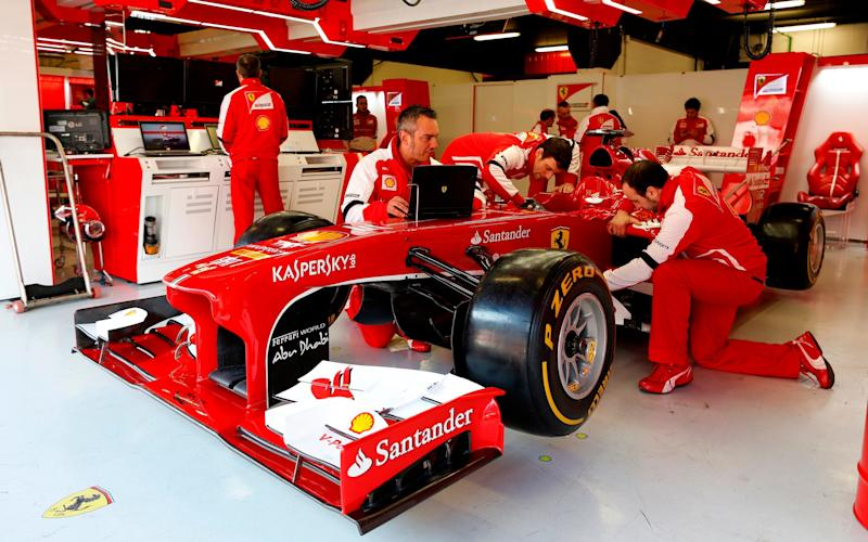 Ferrari F1 car in garage