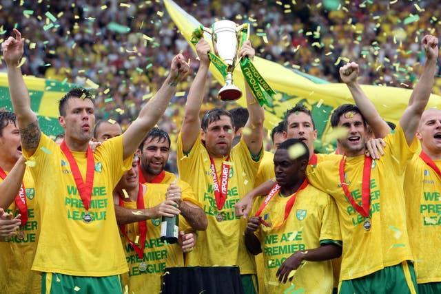 Former Norwich captain Grant Holt (centre) lifts the npower Promotion Trophy