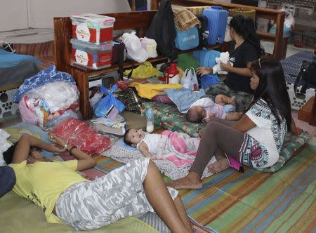 People take shelter inside a Catholic church after evacuating their homes due to super-typhoon Hagupit in Tacloban city, central Philippines December 5, 2014. REUTERS/Rowel Montes