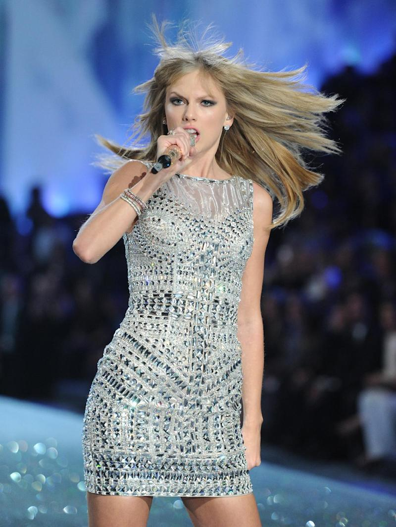 FILE - In this Nov. 13, 2013 file photo, singer Taylor Swift performs on the runway during the 2013 Victoria's Secret Fashion Show at the 69th Regiment Armory in New York. Swift was among the top nominees for the 56th annual Grammy Awards announced Friday night, Dec. 6, 2013. (Photo by Evan Agostini/Invision/AP, File)
