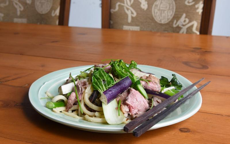 beef with udon noodles and home-made pickles at Sky Kong Kong organic cafe Bristol - Credit: Jay Williams for The Telegraph