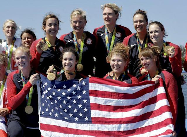 The U.S. women's eight rowing team celebrates after winning Olympic gold Saturday. (AP)
