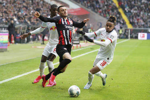Frankfurt Filip Kostic, left, fights for the ball with Christopher Nkunku, right, during a German Bundesliga soccer match between Eintracht Frankfurt and RB Leipzig in Frankfurt, Germany, Saturday, Jan.25, 2020. (Thomas Frey/dpa via AP)