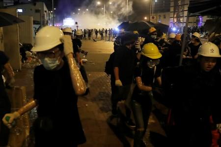 Protesters react after tear gas was fired by police outside the Legislative Council building, after demonstrators stormed the building on the anniversary of Hong Kong's handover to China in Hong Kong