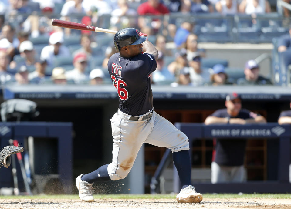 NEW YORK, NEW YORK - AUGUST 17:   Yasiel Puig #66 of the Cleveland Indians follows through on a fifth inning RBI single against the New York Yankees at Yankee Stadium on August 17, 2019 in New York City. (Photo by Jim McIsaac/Getty Images)