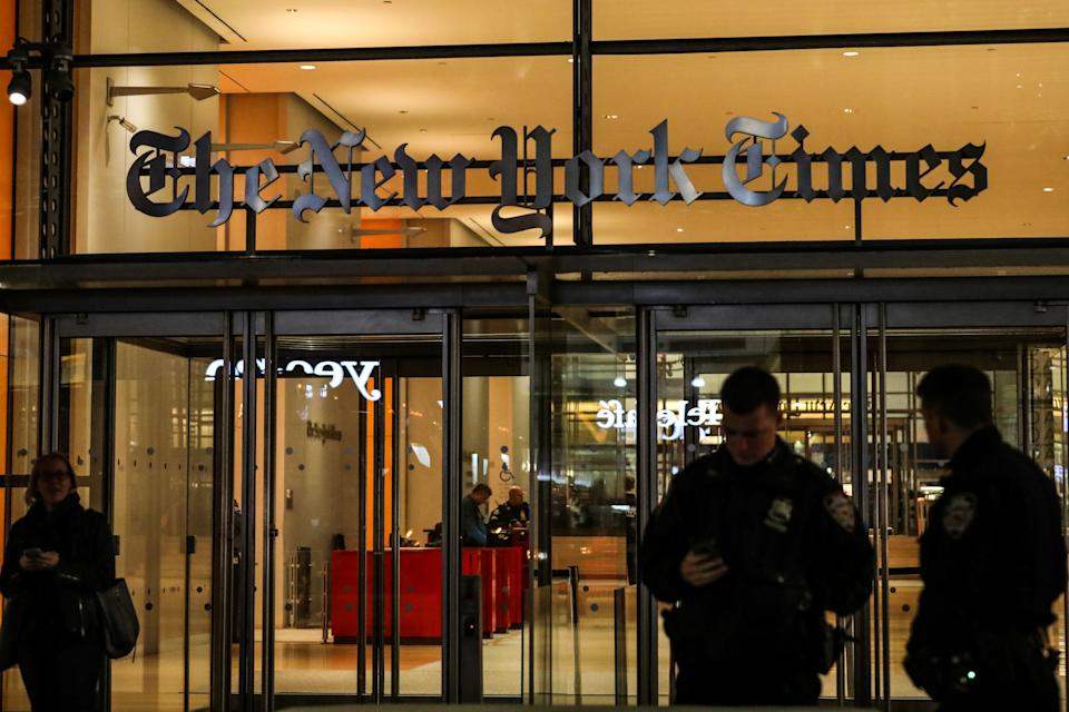 NYPD Police officers stand outside the New York Times Building after reports of a suspicious package was found, in New York City, U.S., October 29, 2018. REUTERS/Jeenah Moon