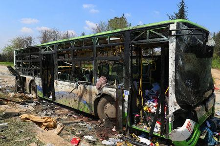 A damaged bus is seen after an explosion yesterday at insurgent-held al-Rashideen, Aleppo province, Syria April 16, 2017. REUTERS/Ammar Abdullah