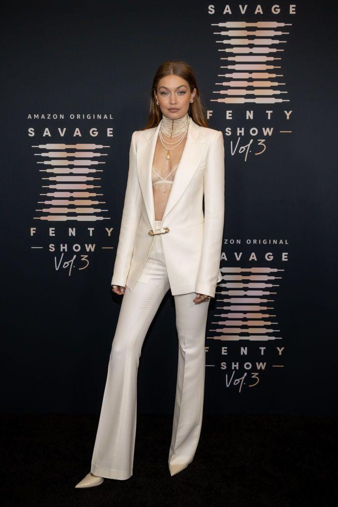 <p><strong>22 September</strong></p><p>Gigi Hadid opted for a crisp white Versace suit and Savage x Fenty bralette. </p>