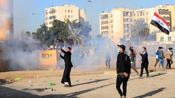 PHOTO: U.S. Embassy security men use tear gas to disperse protesters and militia fighters during a protest to condemn air strikes on bases belonging to Hashd al-Shaabi (paramilitary forces), outside the U.S. Embassy in Baghdad, Iraq January 1, 2020. (Thaier Al-sudani/Reuters)