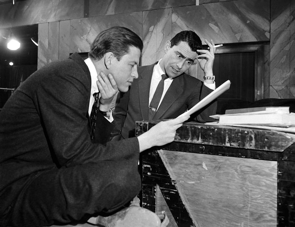 "FILE - In this Feb. 10, 1955, file photo, television writer Rod Serling, right, huddles with producer-director Fielder Cook, backstage at a New York rehearsal for a precedent-making telecast of Serling's ""Patterns,"" on Television Theater. Years before he journeyed to ""The Twilight Zone,"" Serling made a brief detour to the strike zone, writing a comedy about baseball. (AP Photo/Bob Wands, File)"
