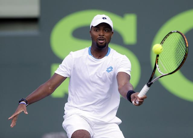 Donald Young returns a shot from John Isner during a match at the Sony Open tennis tournament, Saturday, March 22, 2014, in Key Biscayne, Fla. (AP Photo/Wilfredo Lee)
