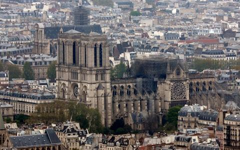 Authorities are reportedly speaking to engineers who recently started work on the Notre-Dame spire - Credit: Thibault Camus/AP