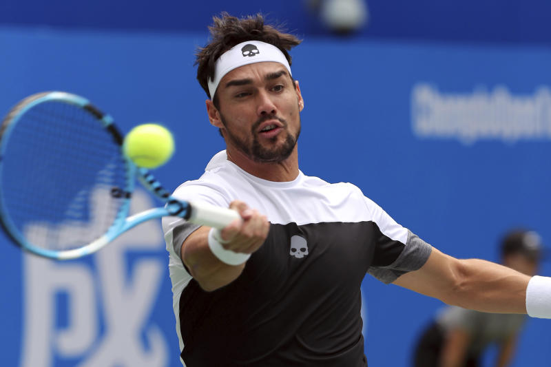 Fabio Fognini of Italy hits a return shot against Taylor Fritz of the United States during their semifinal match in the ATP 250 Chengdu Open tennis tournament in Chengdu in southwestern China's Sichuan province, Saturday, Sept. 29, 2018. Fognini beat Fritz, 2-1. (Chinatopix via AP)