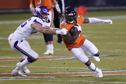 Chicago Bears wide receiver Cordarrelle Patterson (84) runs with the ball as Minnesota Vikings linebacker Troy Dye defends during the first half of an NFL football game Monday, Nov. 16, 2020, in Chicago. (AP Photo/Nam Y. Huh)