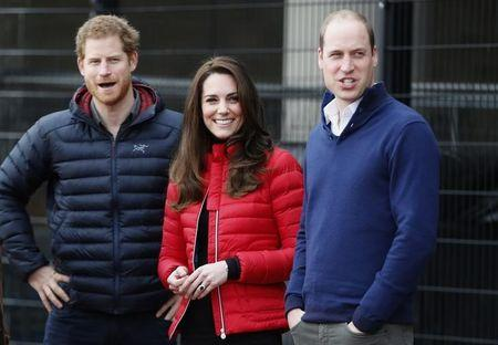 Britain's Prince William, Kate, Duchess of Cambridge, and Prince Harry take part in a relay race, at the Queen Elizabeth II Park in London