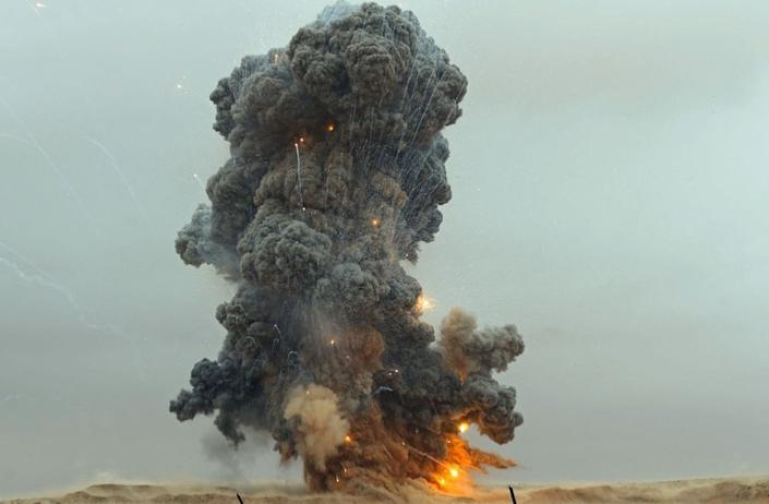 UN-recognised Libyan Government of National Accord (GNA) detonate an explosive device, uncovered from areas south of the capital, in the Libyan capital Tripoli on October 12, 2020.