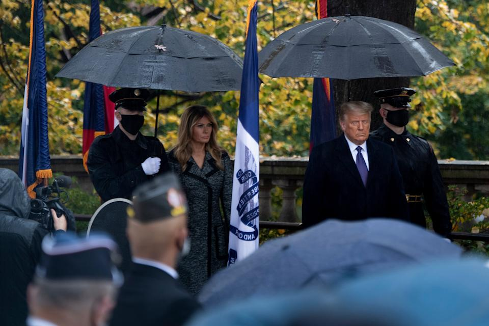 US First Lady Melania Trump and President Donal Trump arrive for a wreath laying ceremony at the Tomb of the Unknown Soldier for Veterans Day at Arlington National Cemetery in Arlington, Virginia, on November 11, 2020. - US President Donald Trump made his first official post-election appearance Wednesday for what should be a moment of national unity to mark Veteran's Day, now marred by his refusal to acknowledge Joe Biden's win. The president visited Arlington National Cemetery, four days after US media projected his Democratic rival would take the White House.