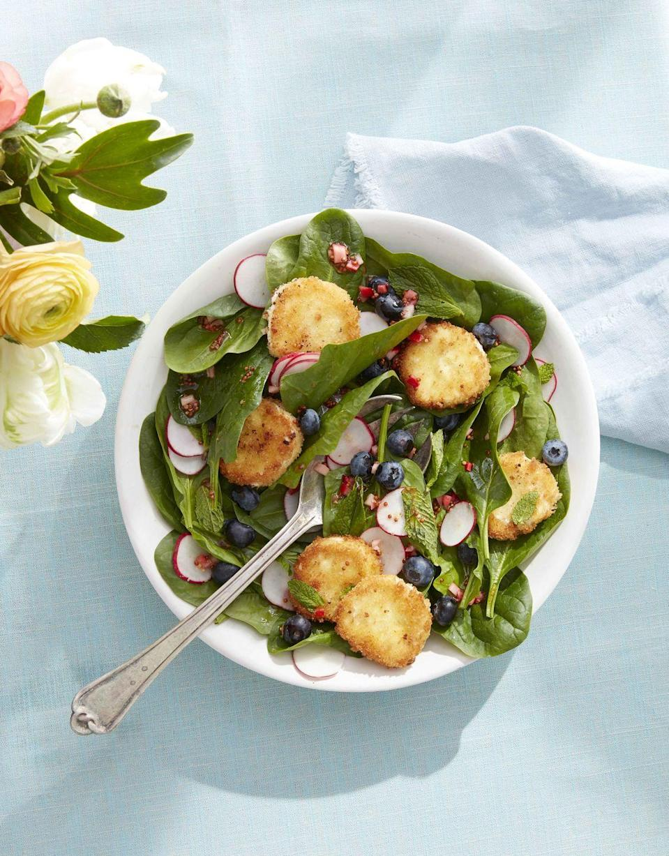 """<p>Served as a side or a main, this fresh and delicious salad is sure to delight. More crispy goat cheese, please!</p><p><strong><a href=""""https://www.countryliving.com/food-drinks/a32042654/spinach-and-mint-salad-with-crispy-goat-cheese/"""" rel=""""nofollow noopener"""" target=""""_blank"""" data-ylk=""""slk:Get the recipe"""" class=""""link rapid-noclick-resp"""">Get the recipe</a>.</strong> </p>"""