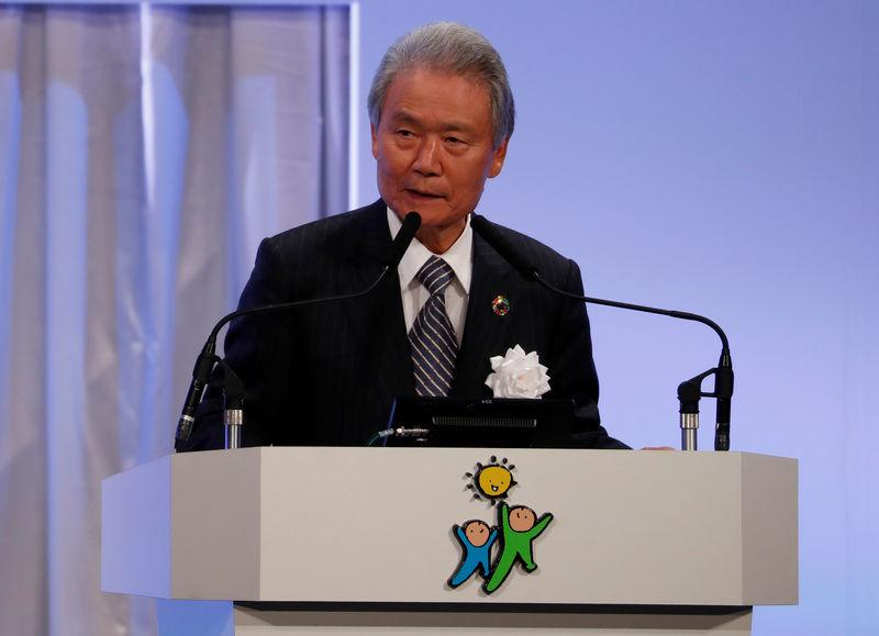 FILE PHOTO: Chairman of Japan Business Federation Sadayuki Sakakibara delivers a speech during the Liberal Democratic Party annual party convention in Tokyo