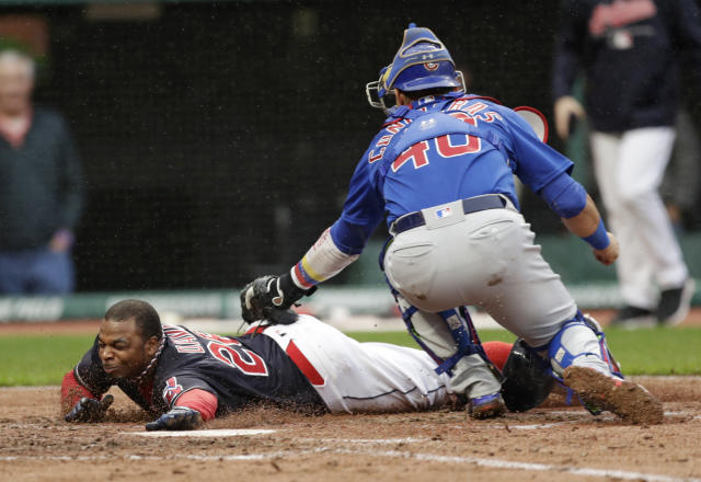Cleveland Indians' Rajai Davis, left, is tagged out by Chicago Cubs catcher Willson Contreras in the third inning of a baseball game, Tuesday, April 24, 2018, in Cleveland. (AP Photo/Tony Dejak)