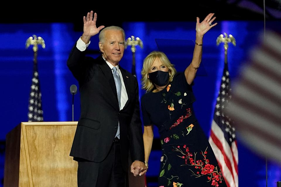 WILMINGTON, DELAWARE - NOVEMBER 07:  President-elect Joe Biden and his wife, Dr. Jill Biden, wave to supporters after addressing the nation from the Chase Center November 07, 2020 in Wilmington, Delaware. After four days of counting the high volume of mail-in ballots in key battleground states due to the coronavirus pandemic, the race was called for Biden after a contentious election battle against incumbent Republican President Donald Trump. (Photo by Andrew Harnik-Pool/Getty Images)