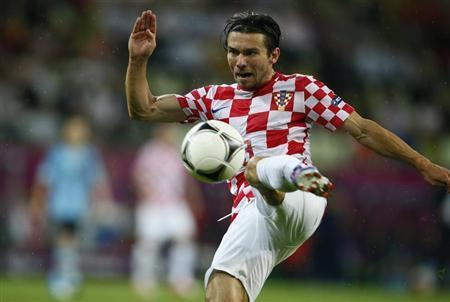 Croatia's Danijel Pranjic shoots the ball during their Group C Euro 2012 soccer match against Spain at the PGE Arena in Gdansk June 18, 2012. REUTERS/Kai Pfaffenbach