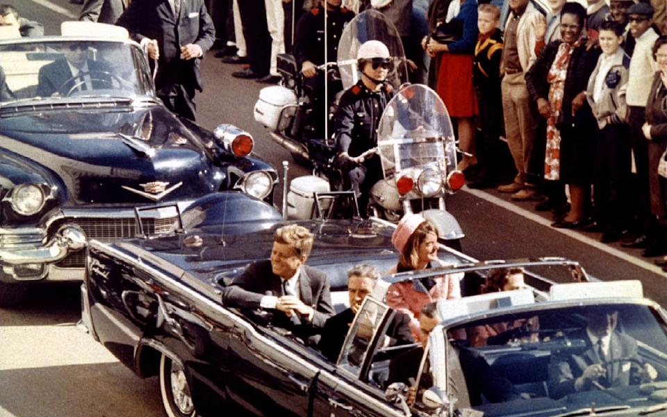 President John F. Kennedy, Jaqueline Kennedy and Texas Governor John Connally ride in a liousine moments before Kennedy was assassinated, in Dallas - Reuters
