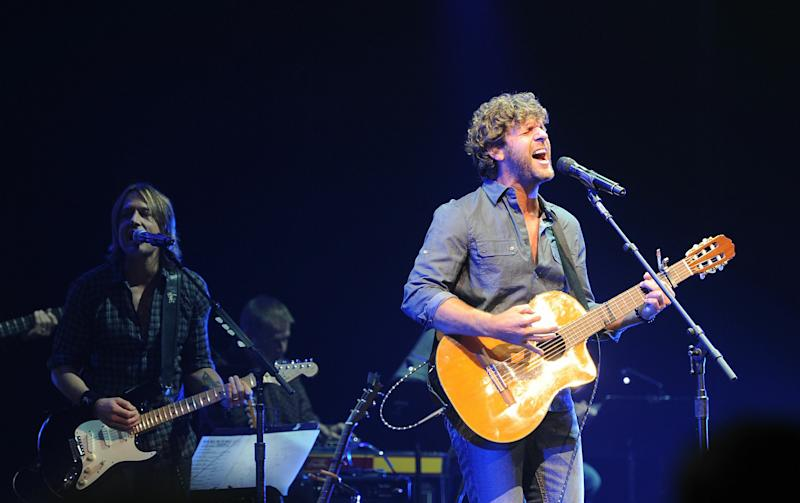 NASHVILLE, TN - OCTOBER 05:  Keith Urban and Billy Currington perform onstage at the 2010 We're All For The Hall benefit concert at the Bridgestone Arena on October 5, 2010 in Nashville, Tennessee.  (Photo by Rick Diamond/Getty Images)