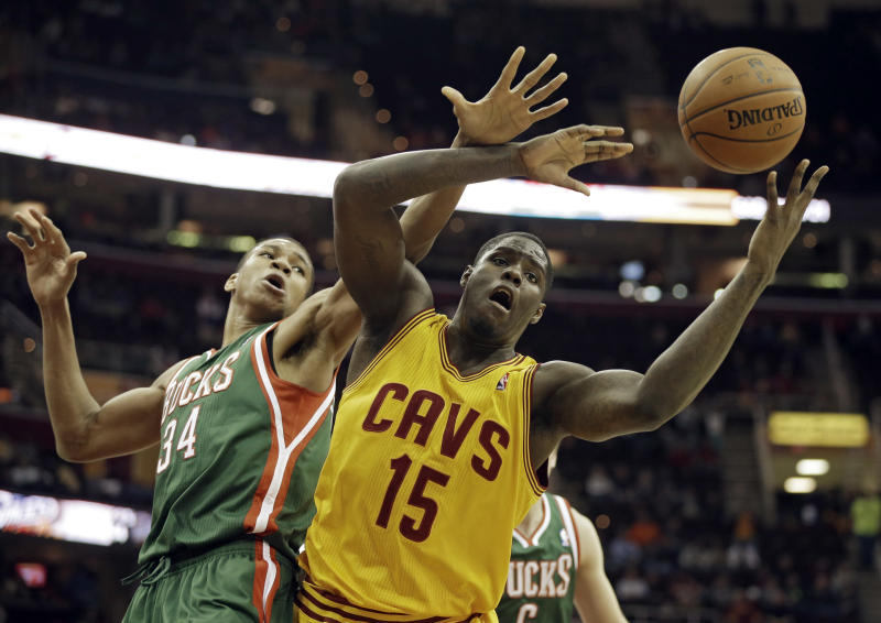 Cleveland Cavaliers' Anthony Bennett (15) fights for a rebound with Milwaukee Bucks' Giannis Antetokounmpo, from Greece, in the fourth quarter of an NBA basketball game, Friday, Jan. 24, 2014, in Cleveland. The Cavaliers won 93-78. (AP Photo/Mark Duncan)