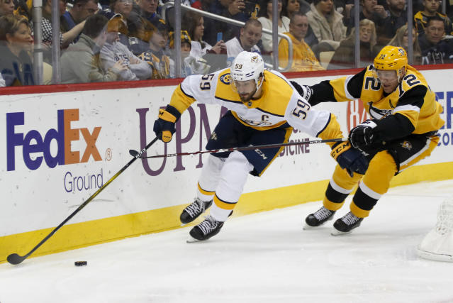 Nashville Predators' Roman Josi (59) brings the puck around the net as Pittsburgh Penguins' Patric Hornqvist (72) pursues during the second period of an NHL hockey game Saturday, Dec. 28, 2019, in Pittsburgh. (AP Photo/Keith Srakocic)