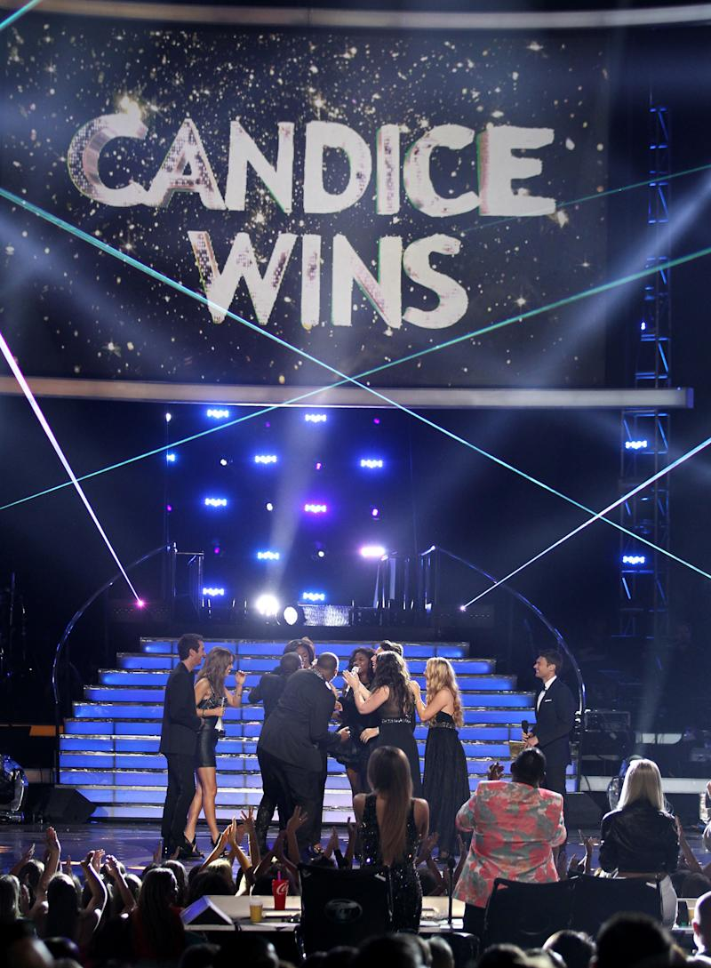 "Contestants congratulate winner Candice Glover at the ""American Idol"" finale at the Nokia Theatre at L.A. Live on Thursday, May 16, 2013, in Los Angeles. (Photo by Matt Sayles/Invision/AP)"