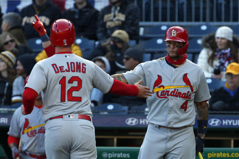 Paul DeJong and Yadier Molina exchange a high-five.
