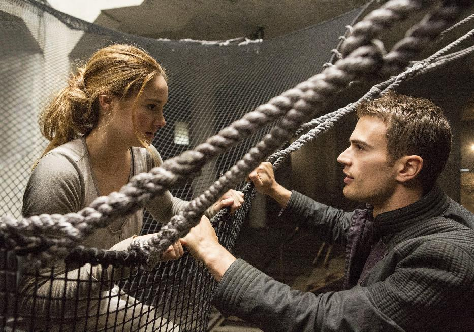 """This image released by Summit Entertainment shows Shailene Woodley, left, and Theo James in a scene from """"Divergent."""" The movie releases on Friday, March 21, 2014. (AP Photo/Summit Entertainment, Jaap Buitendijk, file)"""