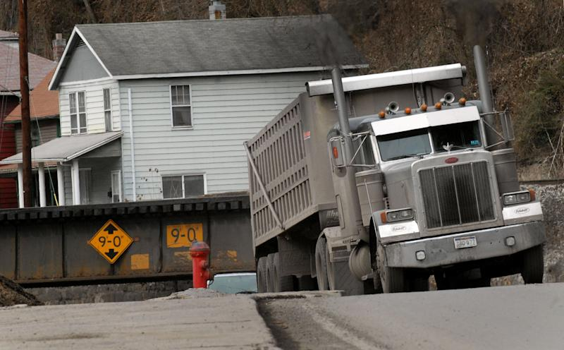 A coal truck drives through an railroad tressel near downtown Welch, W.Va., Wednesday, Feb. 9, 2011. Coal brought a large population to the McDowell County in the 1940's. Now the population is shrinking and the county suffers from unemployment and poverty. (AP Photo/Jon C. Hancock)