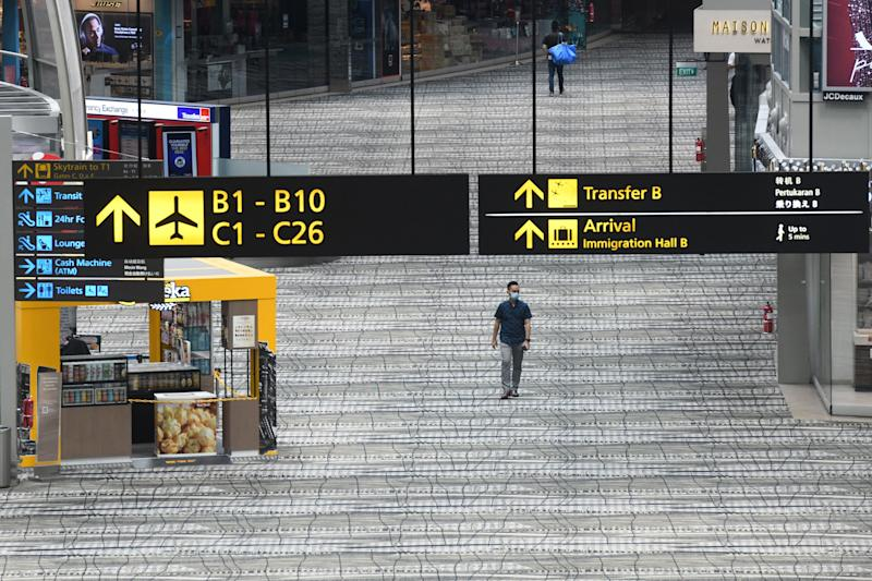 A man walks along the transit area at Changi International Airport terminal in Singapore on June 8, 2020, as Singapore prepares to reopen its borders after shutting them to curb the spread of the COVID-19 novel coronavirus. (Photo by Roslan RAHMAN / AFP) (Photo by ROSLAN RAHMAN/AFP via Getty Images)