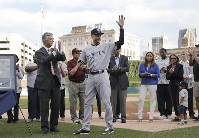 New York Yankees shortstop Derek Jeter acknowledges the crowd in a special on-field ceremony before a baseball game against the Detroit Tigers in Detroit Wednesday, Aug. 27, 2014. (AP Photo/Paul Sancya)