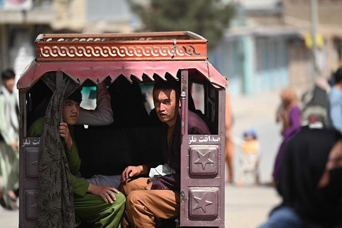 Image: Hazara men travel on a three-wheeler vehicle on the outskirts of Kabul, Afghanistan on Sept. 10, 2021. (Aamir Qureshi / AFP - Getty Images)