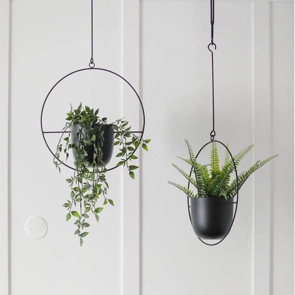 <p>The <span>Abetree Modern Geometric Black Hanging Planters, Set of 2</span> ($35) are so chic and minimalist.</p>