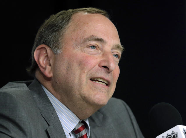 FILE - In this June 6, 2019, file photo, NHL Commissioner Gary Bettman speaks during a news conference before Game 5 of the NHL hockey Stanley Cup Final between the St. Louis Blues and the Boston Bruins in Boston. Under the terms of the collective bargaining agreement, NHL owners and players divide hockey-related revenue 50/50, and if player salaries exceed that split a certain percentage is withheld in escrow to make it even. The Chicago Blackhawks captain Jonathan Toews and fellow players have lost upwards of 10% of their pay to escrow over the past seven seasons, which is why 25 of 31 NHL Players Association representatives surveyed by The Associated Press and Canadian Press named escrow as the biggest bargaining issue with September deadlines looming to terminate the current CBA effective the fall of 2020. (AP Photo/Charles Krupa, File)